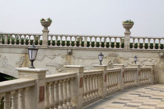 Stone bridge banisters and lighting lamps and lanterns. Stone bridge banisters and lighting lamps in a park Royalty Free Stock Photos