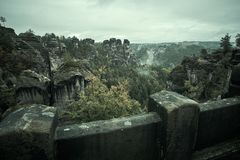 Stone bridge Bastei in Saxon Switzerland with the rainy mist over the river Elbe, National park Saxon Switzerland royalty free stock image