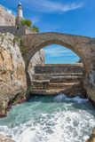 Stone bridge in Castro Urdiales, Cantabria, Spain Royalty Free Stock Photography