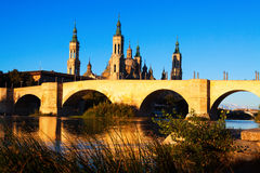 Stone bridge and  Cathedral in sunny morning. Zaragoza Royalty Free Stock Photos