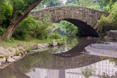 Stone Bridge Central Park New York City. A stone bridge in Central Park with its trees, Manhattan Island, New York City Royalty Free Stock Images
