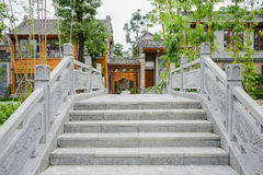 Stone bridge before Chinese traditional buildings Stock Image