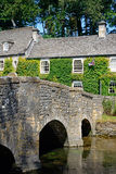 Stone bridge and cottages, Bibury. Pretty Cotswold stone bridge across the River Coln with The Swan Hotel to the rear, Bibury, Cotswolds, Gloucestershire Royalty Free Stock Photos