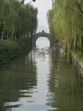 Stone bridge cross water channel at westlake hangzhou Royalty Free Stock Photo