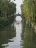 Stone bridge cross water channel at westlake hangzhou Royalty Free Stock Photo