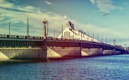 Stone bridge crossing the Daugave river in Riga city Royalty Free Stock Images