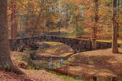 The Stone Bridge at Flat Rock Park. `The Stone Bridge at Flat Rock Park` is photo taken at the Flat Rock Park, located in Columbus, Georgia royalty free stock photo