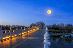 stone bridge with full golden moon Royalty Free Stock Images