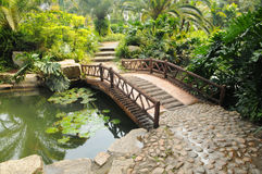 Stone bridge in garden Stock Photography