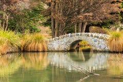 Stone bridge in  garden Royalty Free Stock Image