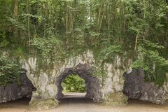 Stone bridge and green vegetation with three tunnels. In the citadel park in Ghent Belgium on a wonderful day to enjoy royalty free stock images