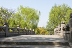 Stone bridge and green willow Royalty Free Stock Photography
