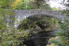 Stone bridge at Invermoriston in the Highlands. This stone bridge can be found in Invermoriston which is located in the Highlands of Scotland. It spans the river Royalty Free Stock Photos