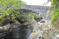 Stone bridge at Invermoriston in the Highlands. This stone bridge can be found in Invermoriston which is located in the Highlands of Scotland. It spans the river Stock Images