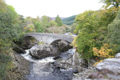 Stone bridge at Invermoriston in the Highlands. This stone bridge can be found in Invermoriston which is located in the Highlands of Scotland. It spans the river Royalty Free Stock Image