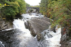 Stone bridge at Invermoriston in the Highlands. This stone bridge can be found in Invermoriston which is located in the Highlands of Scotland. It spans the river Stock Image