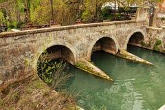 Stone bridge and the Jucar River in Alcala del Jucar village royalty free stock photo