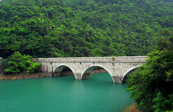 Stone bridge on lake Royalty Free Stock Photography