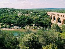 Stone bridge. Landscape view of the Gardon river in Provence, France and the Pont du Gard Royalty Free Stock Images