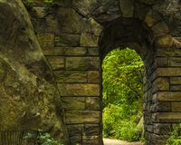 Getaway to heaven. Stone bridge located in Central Park, New York, the structure of which brings to mind entrance to heaven Royalty Free Stock Images