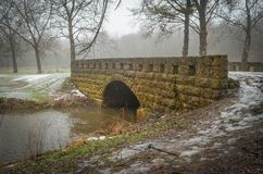 Stone Bridge. A stone bridge located in Seward Bluffs Forest Preserve near Pecatonica, Illinois in winter stock photo