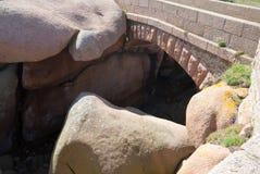 Stone bridge made from rose granite rocks Royalty Free Stock Image