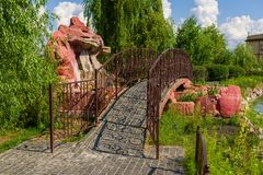 Stone bridge with metal railings. In landscape design royalty free stock photography