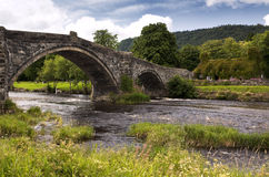 Stone bridge and old cottage at Llanrwst Stock Photos