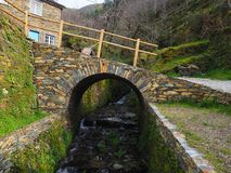 A stone bridge in an old village in Portugal. Stone bridge old village portugal royalty free stock photos