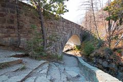 Free STONE BRIDGE OVER BARING CREEK ON THE GOING TO THE SUN ROAD IN GLACIER NATIONAL PARK IN MONTANA USA Royalty Free Stock Image - 107651756