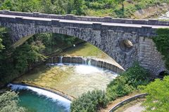 Stone bridge over the brook in the mountains with. Old stone bridge over the river in the mountains with Royalty Free Stock Images
