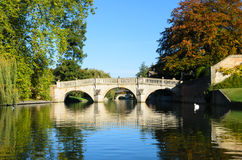 Stone bridge over Cam river in Cambridge. Medieval stone bridge reflecting in the calm water of the Cam river in Cambridge, United Kingdom Stock Image