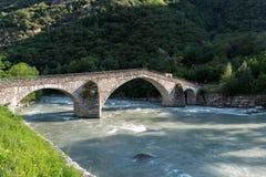 Stone bridge over the Dora Baltea River, Echallod, near Issogne Stock Photos