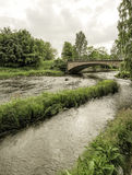 Stone Bridge over Gavle River. With a cloudy sky royalty free stock image