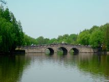 A stone bridge over a lake Stock Photo