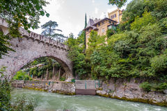 Stone bridge over Passer river in Merano Stock Image