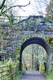 Stone bridge over a path in the Hermitage Forest, Scotland Royalty Free Stock Photography