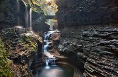 Stone bridge over Rainbow Falls in Watkins Glen State Park Royalty Free Stock Photos