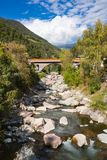 Stone bridge over river Isarco, Chiusa, Italy stock images