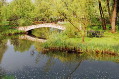 Stone bridge over river or lake in countryside, stormy sky Stock Images