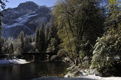 Stone bridge over river with snow Royalty Free Stock Images