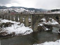 Stone bridge over the river Stock Photo