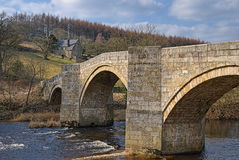 Stone bridge over River Wharfe Stock Image