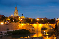 Stone bridge over Segura river   in evening. Murcia Stock Image