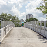 Stone bridge over small lake. In Chinese and Japanese Gardens in Singapore Royalty Free Stock Photos