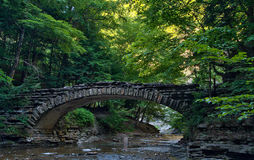 Stone bridge over a stream in Stony Brook State Park Stock Images