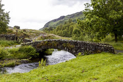 Stone Bridge over Watendlath Beck. Watendlath, English Lake District. Royalty Free Stock Photo
