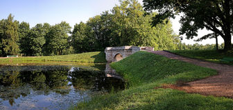 Stone Bridge. In a park in Gatchina on the shores of Silver Lake Royalty Free Stock Image