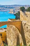 The bridge in fortress of Valletta, Malta. The stone bridge between the parts of St Peter and Paul bastion and counterguards, Valletta, Malta Royalty Free Stock Photography