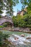 Stone bridge with Passer river in Merano Stock Photography